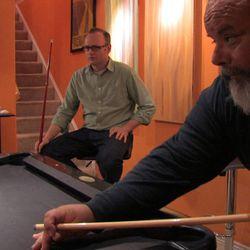 Bryan Hall and Ruben Israel play pool at Bryan Hall's house.