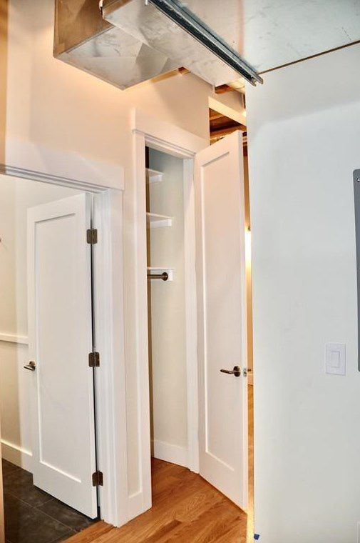 A small short hallway with doors off it.