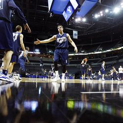BYU's Jimmer Fredette, center, fives teammates during a shooting drill during practice. BYU faces Florida at 10:20 a.m. today in Oklahoma City.