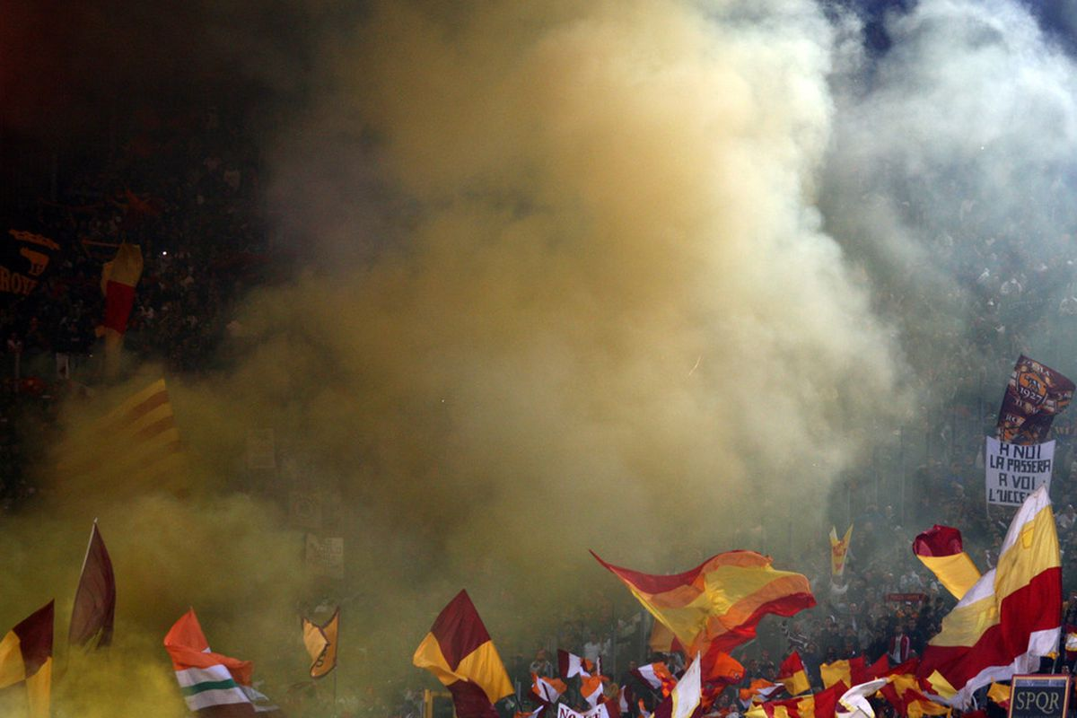 ROME, ITALY - OCTOBER 16:  Fans of AS Roma supports their team during the Serie A match between SS Lazio and AS Roma at Stadio Olimpico on October 16, 2011 in Rome, Italy.  (Photo by Paolo Bruno/Getty Images)