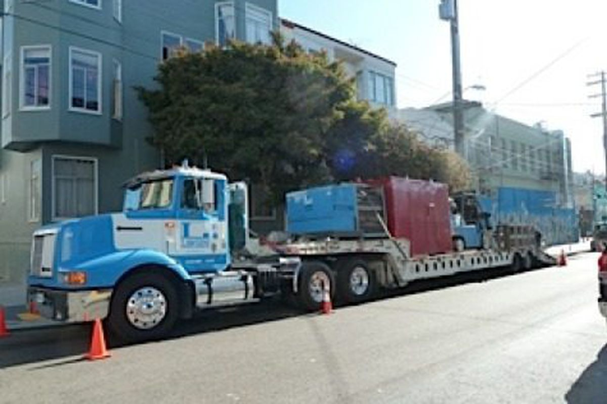 The J & R smoker was delivered on a flat bed truck.