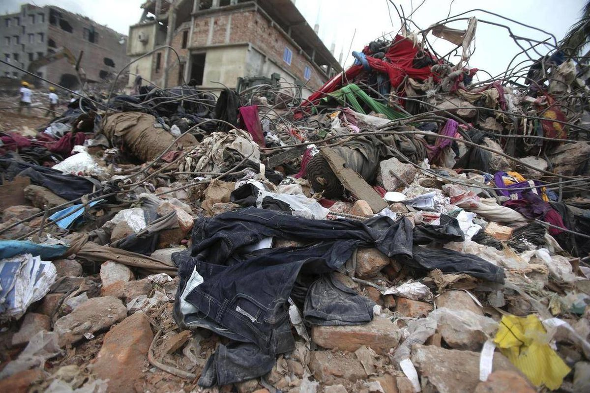 Pairs of brand new denim jeans are strewn over rubble from the collapsed garment factory building, Saturday, May 4, 2013 in Savar, near Dhaka, Bangladesh. In the aftermath of last week's building collapse that killed more than 530 people, Bangladesh's gar