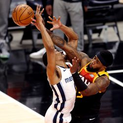 Utah Jazz forward Royce O'Neale (23) fouls Memphis Grizzlies guard De'Anthony Melton (0) as the Utah Jazz and Memphis Grizzlies play Game 2 of their NBA playoffs first round series at Vivint Arena in Salt Lake City on Wednesday, May 26, 2021.