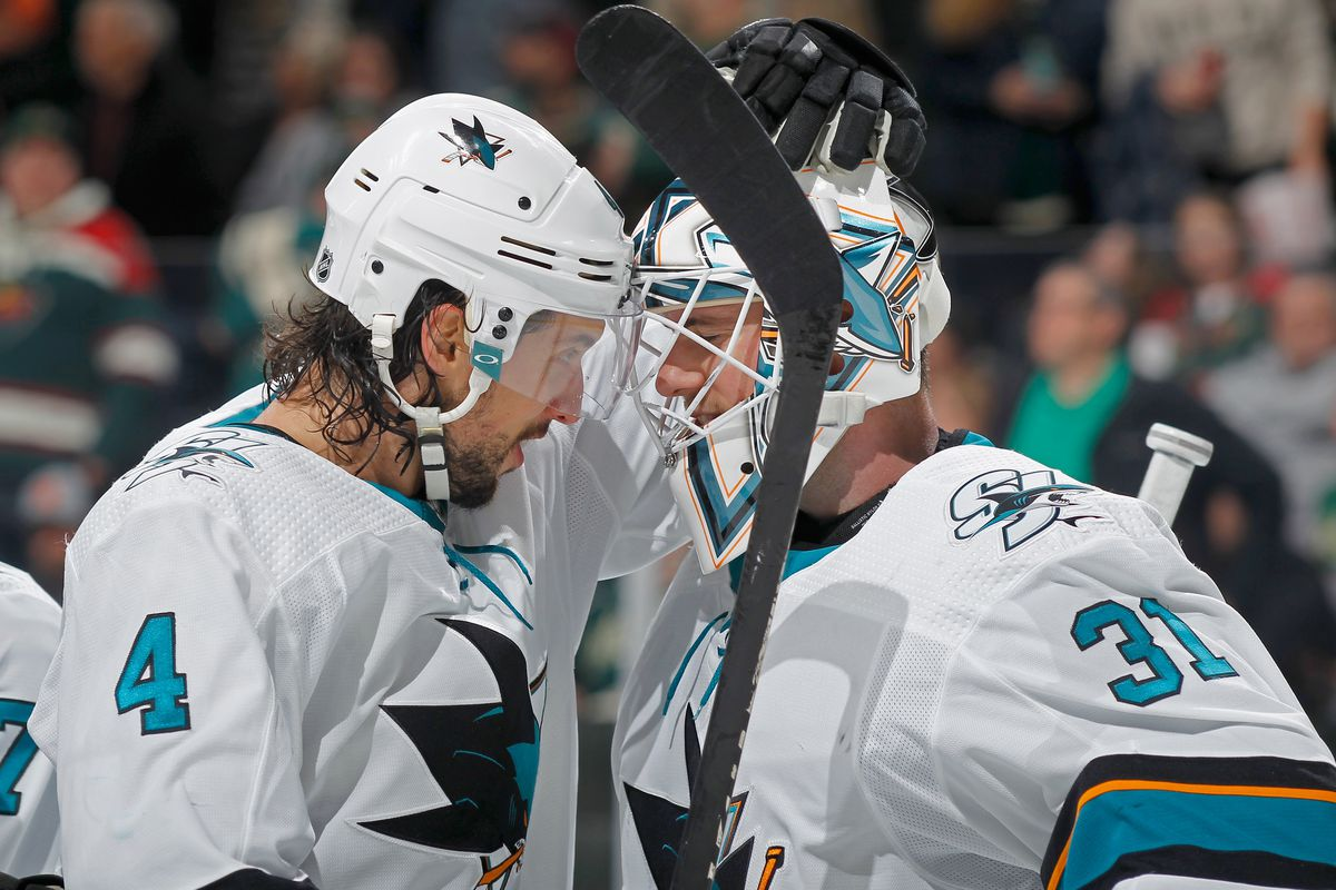 ST PAUL, MINNESOTA - FEBRUARY 15: Brenden Dillon #4 and Martin Jones #31 of the San Jose Sharks celebrate defeating the Minnesota Wild after the game on February 15, 2020 in St Paul, Minnesota. The Sharks defeated the Wild 2-0.