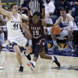 BYU guard Connor Harding (44) defends Texas Southern forward Justin Hopkins (15) during the Cougars' 87-71 victory at the Marriott Center in Provo on Monday, Dec. 21, 2020.