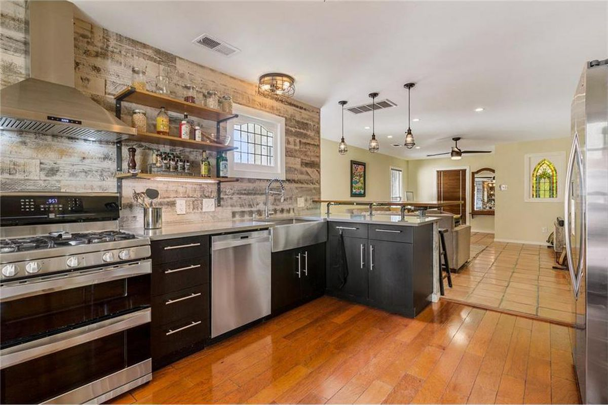 Open kitchen/living area with partial brick wall