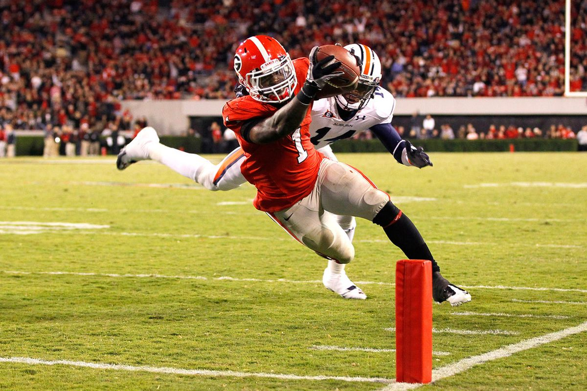 ATHENS, GA - NOVEMBER 12:  Isaiah Crowell #1 of the Georgia Bulldogs dives for a touchdown past Erique Florence #14 of the Auburn Tigers at Sanford Stadium on November 12, 2011 in Athens, Georgia.  (Photo by Kevin C. Cox/Getty Images)