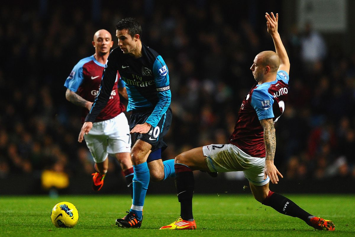 of the three photos of this play, this is the one where Alan Hutton gets closest to the ball