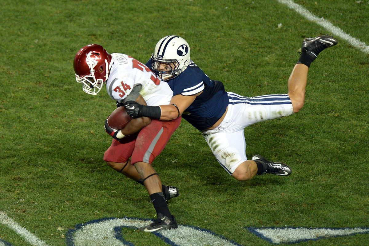 Spencer Hadley records a tackle against Washington State