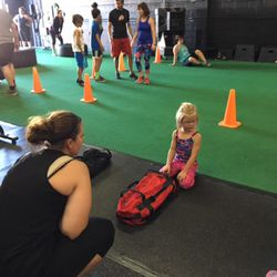 Jennifer Taylor explains how the bag flipping exercise works to her 5-year-old daughter, Ashley.