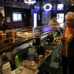 n this photo taken Friday, Sept. 7, 2012, Bartender irene Rivera, right, opens the King Eddy Saloon, one of the oldest and most colorful dive bars in Los Angeles. The King Eddy Saloon located near the Skid Row will close next September after more than 100 years as a bar.