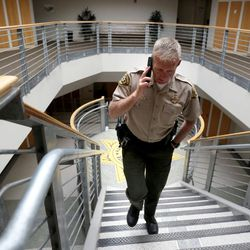 Salt Lake County Sheriff Jim Winder walks to his office after announcing that he will leave his elected position to become  Moab's police chief during a press conference at the Salt Lake County Sheriff's Office in Salt Lake City on Tuesday, May 30, 2017.