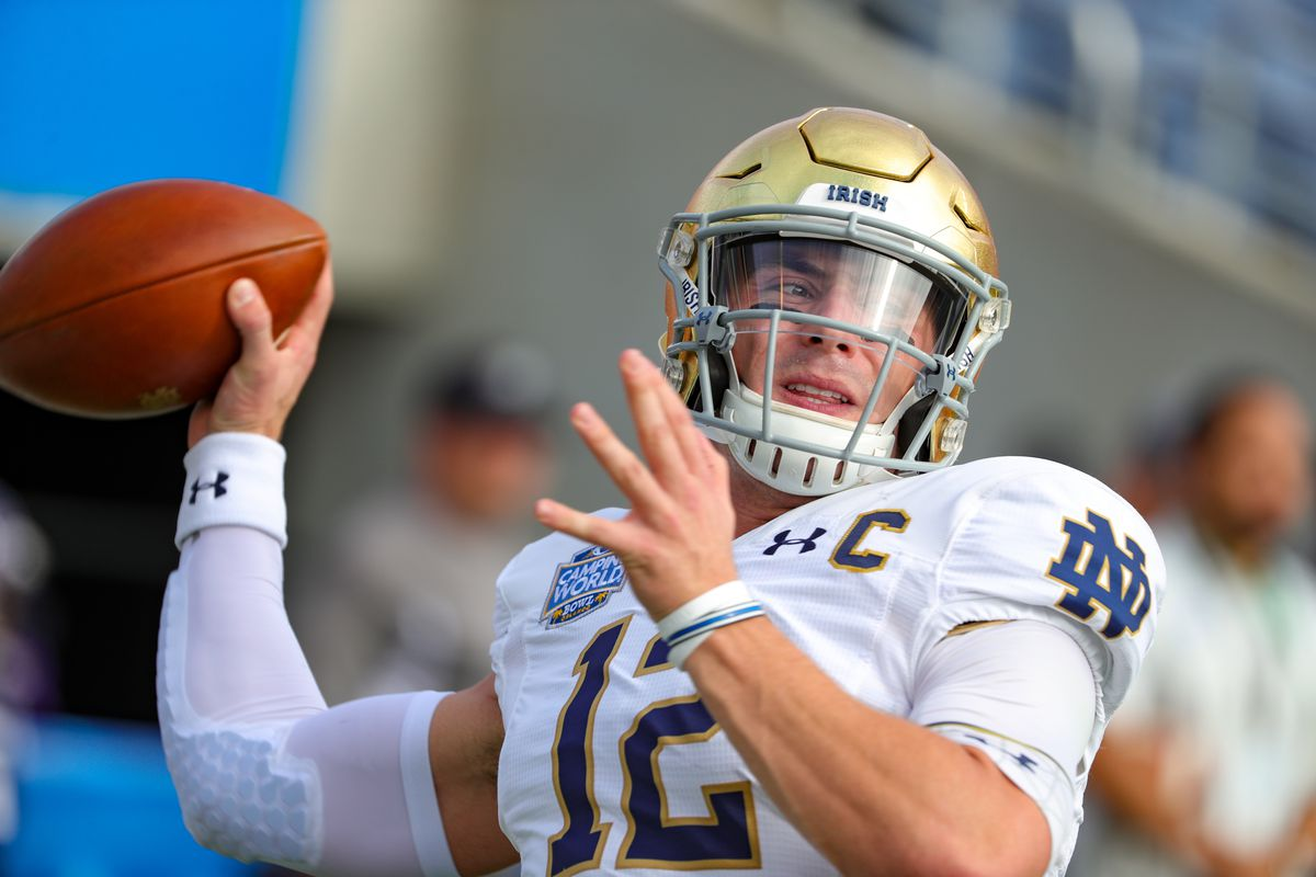 Notre Dame Fighting Irish quarterback Ian Book warms up before the Camping World Bowl between Notre Dame and Iowa State on December 28, 2019, at Camping World Stadium in Orlando FL.