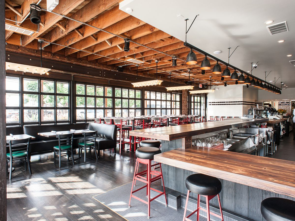 An industrial-looking barbecue restaurant with exposed ceiling.