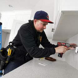 Jake Johnson does electrical work at a new home in Farmington on Thursday, Feb. 4, 2016.