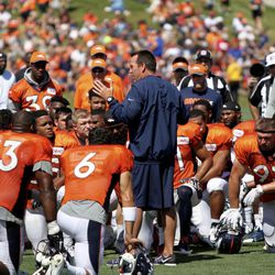 Denver Broncos Head Coach Gary Kubiak addresses the team after their last training camp practice, which was a joint practice with the San Francisco 49ers.