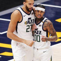 Utah Jazz center Rudy Gobert (27) and Utah Jazz guard Jordan Clarkson (00) talk after a play as Utah Jazz and LA Clippers play in an NBA basketball game at Vivint Smart Home Arena in Salt Lake City on Friday, Jan. 1, 2021. Utah won 106-100.