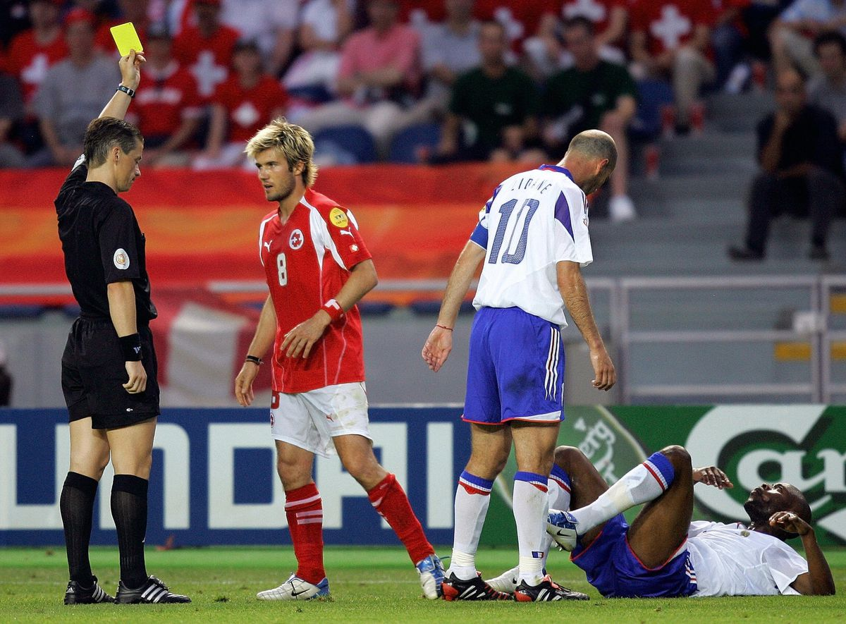 Slovakian referee Lubos Michel (L) gives
