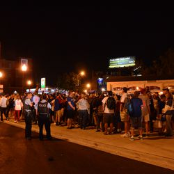 10:38 p.m. Line for the remote parking lot buses, at Sheffield and Addison. This is not the end of the line -