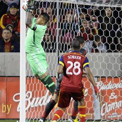Real Salt Lake goalkeeper Nick Rimando (18) makes a save during a game at Rio Tinto Stadium in Sandy on Saturday, March 29, 2014.