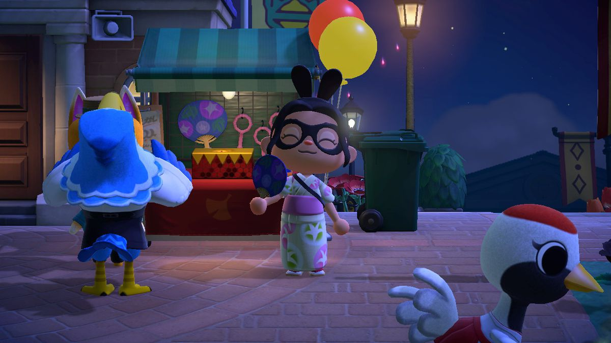 An Animal Crossing character happily holds a fan