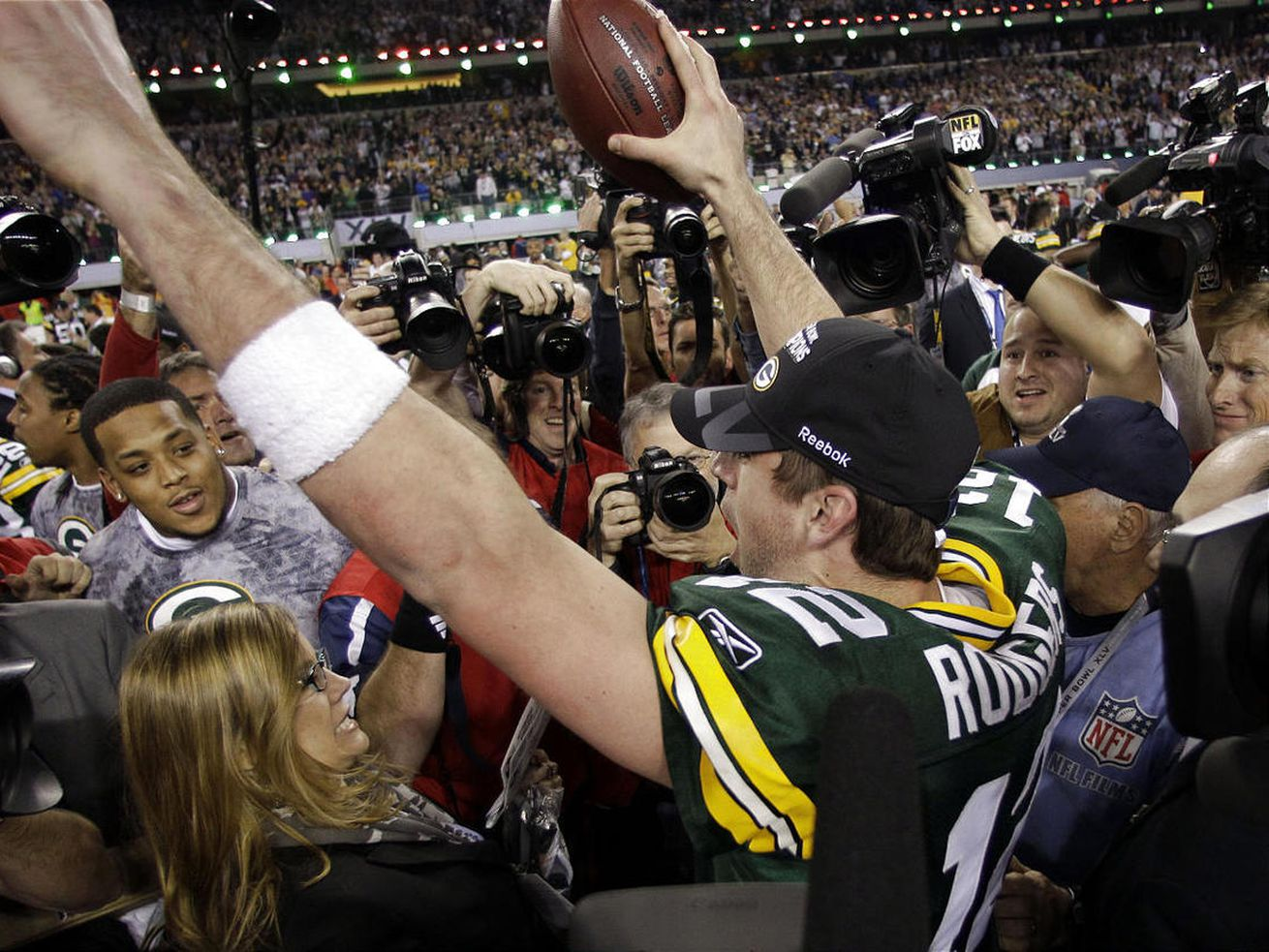 Aaron Rodgers, right, holds the Vince Lombardi Trophy alongside teammate Clay Matthews.