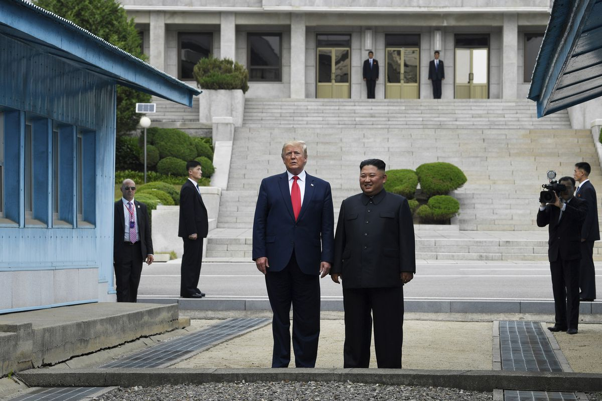 In this Sunday, June 30, 2019 file photo, U.S. President Donald Trump, center left, and North Korean leader Kim Jong Un stand on the North Korean side of the Demilitarized Zone in Panmunjom.