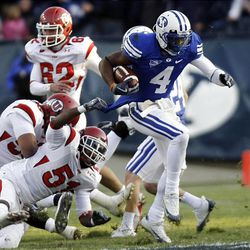 BYU wide receiver O'Neill Chambers runs away from Utah linebacker Jamel King during their game against Utah at LaVell Edwards Stadium in Provo Saturday. BYU won 26-23 in overtime.
