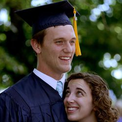Clara Flake looks up to her husband, Derek Flake, after he received his bachelor's in management degree at Brigham Young University's commencement exercises at the Marriott Center in Provo on Thursday, Aug. 13, 2015.