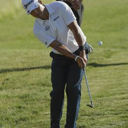 Hideki Matsuyama, of Japan, chips to the 18th green during the fourth round of the U.S. Open golf tournament Sunday, June 18, 2017, at Erin Hills in Erin, Wis.