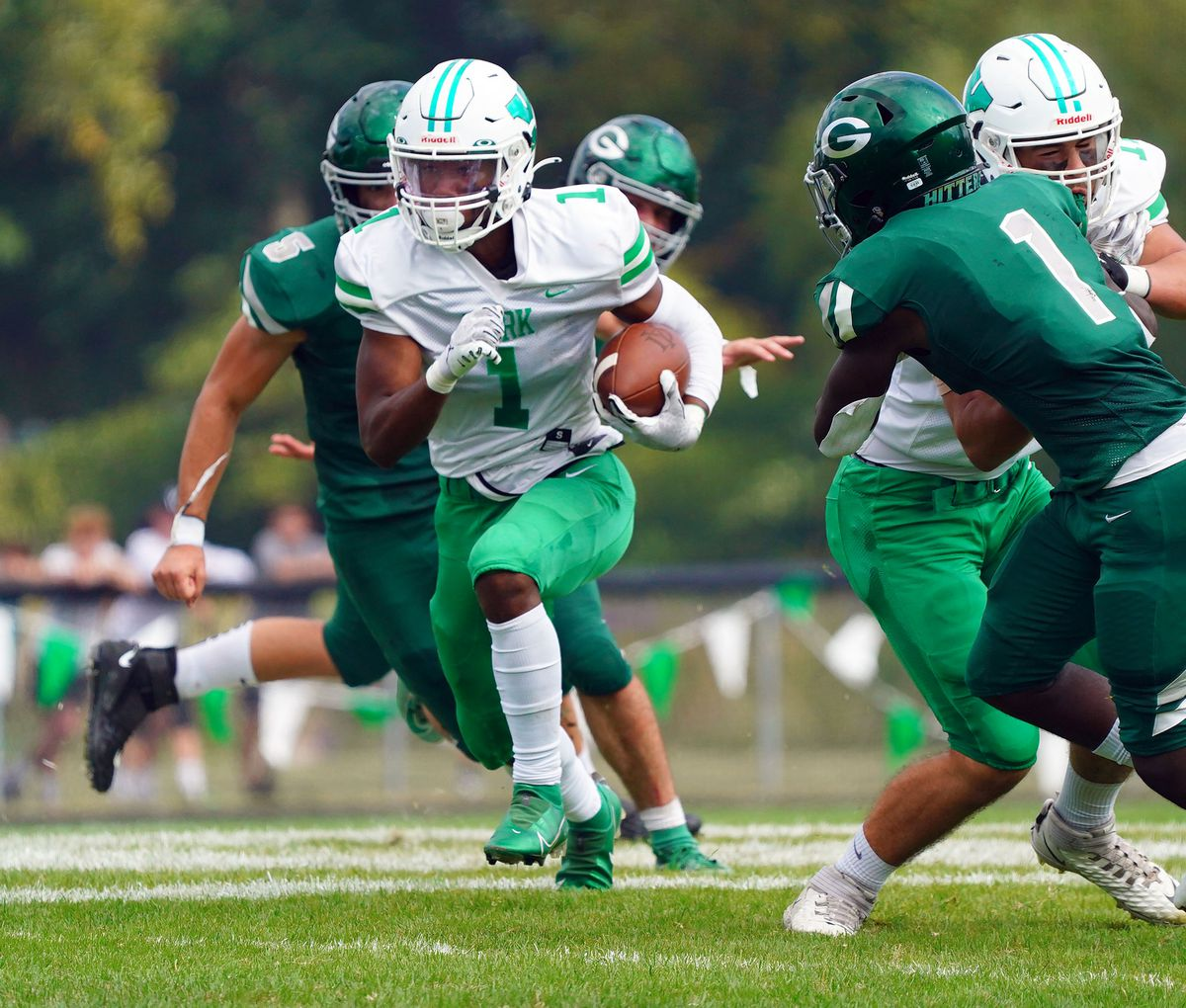 York's Kelly Watson (1) finds a hole in the Glenbard West defense.