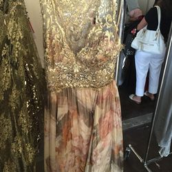 Gold halter gown with rose print, $900