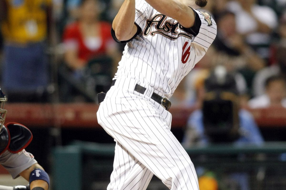 Sep 24, 2012; Houston, TX, USA; Houston Astros third baseman Scott Moore (46) hits a RBI single against the St. Louis Cardinals in the second inning at Minute Maid Park. Mandatory Credit: Brett Davis-US PRESSWIRE
