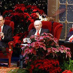 """The First Presidency: President Thomas S. Monson, left, President Gordon B. Hinckley and President James E. Faust sing """"Silent Night"""" with the Tabernacle Choir and the congregation during The First Presidency Christmas Devotional at the Conference Center in December 2001."""