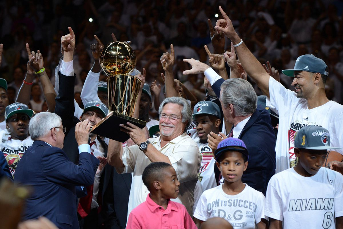Miami Heat owner Micky Arison lifts the Larry O'Brien Trophy after his team won the 2012 NBA Finals.