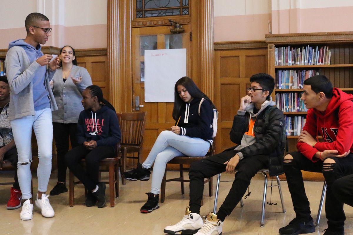 Students participate in a peer mentoring program at Cypress Hills Collegiate Preparatory School.