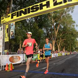 Ryan Raff, left, and Conner Mantz place second and third in the men's division of the Deseret News Half Marathon at Liberty Park in Salt Lake City on Friday, July 23, 2021.