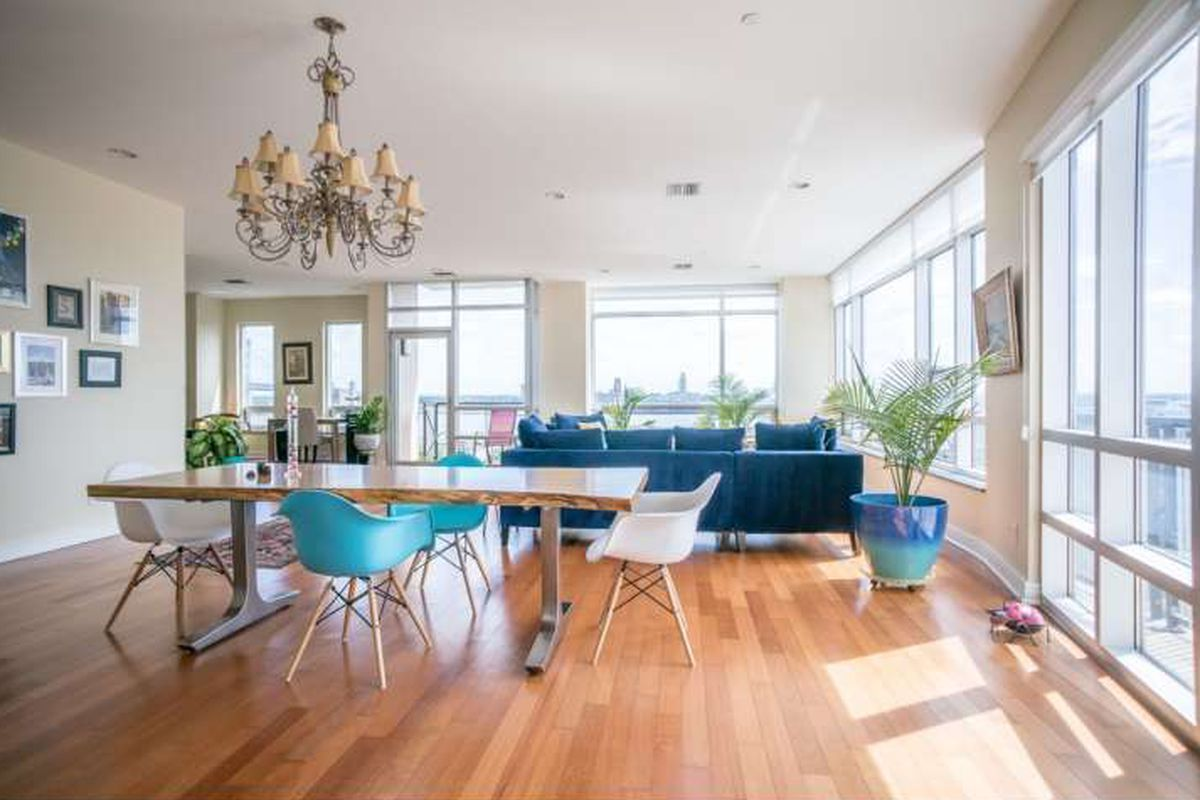 A sunny corner condo with hardwood floors and floor-to-ceiling windows.