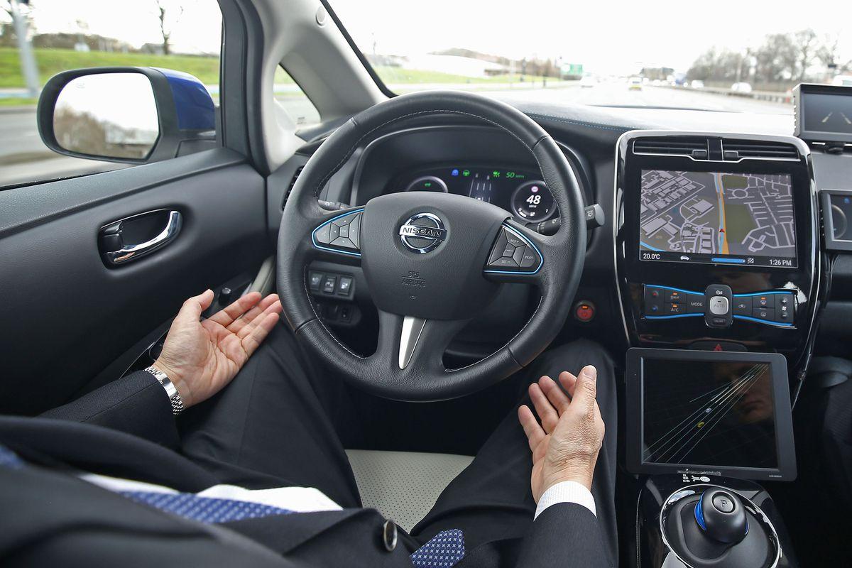 Tetsuya Lijima demonstrates a prototype Nissan Leaf driverless car around the roads of East London.