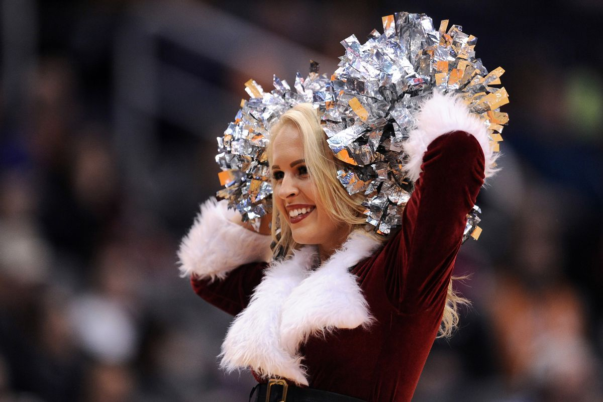 This Phoenix Suns dancer does NOT want to hear the score of yesterday's game, but seems to be in the holiday spirit, nonetheless...