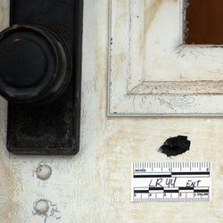 A bullet hole marked in the front door of the home at 3268 Jackson Ave. in Ogden, Tuesday, Jan. 10, 2012.