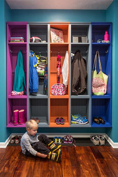 Mudroom With Color-Coded Shelves