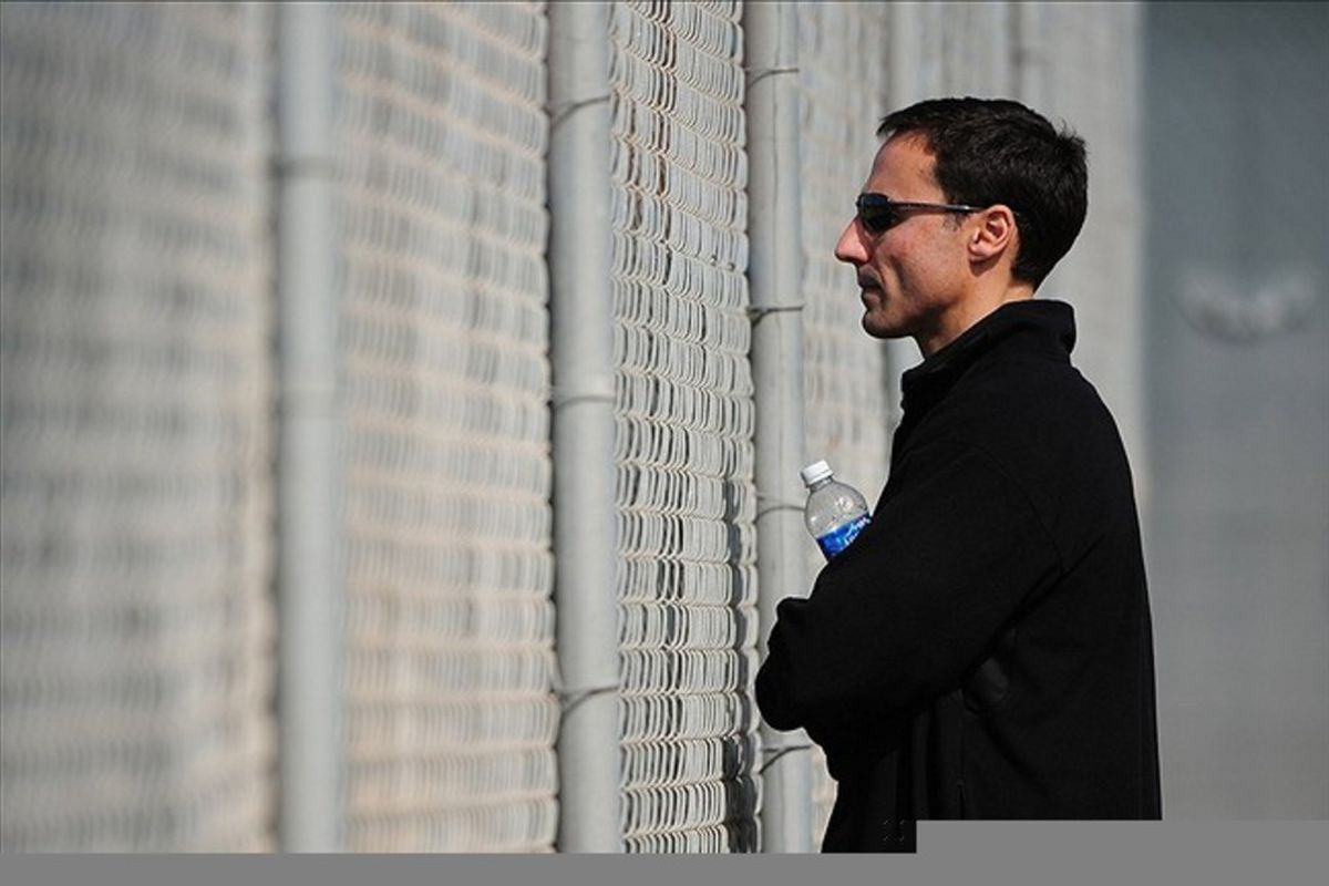 February 22, 2012; Goodyear, AZ, USA; Cleveland Indians general manager Chris Antonetti watches a bullpen session during spring training at the Cleveland Indians Player Development Complex. Mandatory Credit: Kyle Terada-US PRESSWIRE