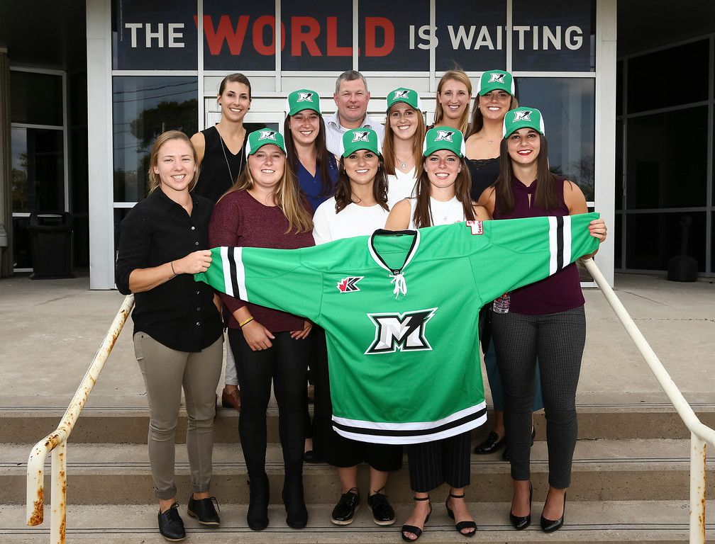 2018 CWHL Draft - Markham Thunder picks holding a Thunder jersey while standing on the steps of the Mastercard Centre
