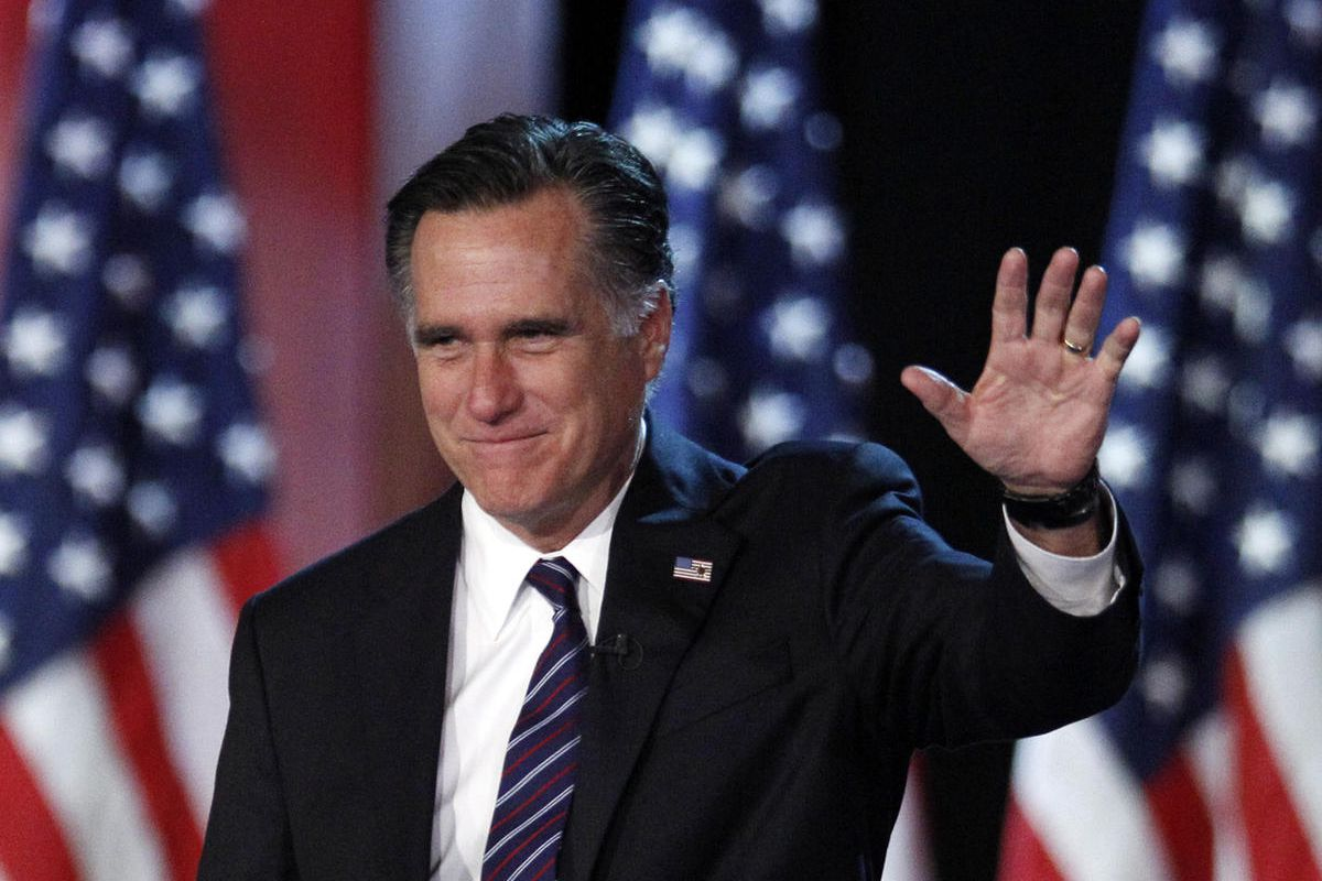 FILE - This Nov. 7, 2012 file photo shows Republican presidential candidate, former Massachusetts Gov. Mitt Romney waving to supporters at an election night rally in Boston. Romney's shadow looms over a GOP in disarray. Republican officials in Washington