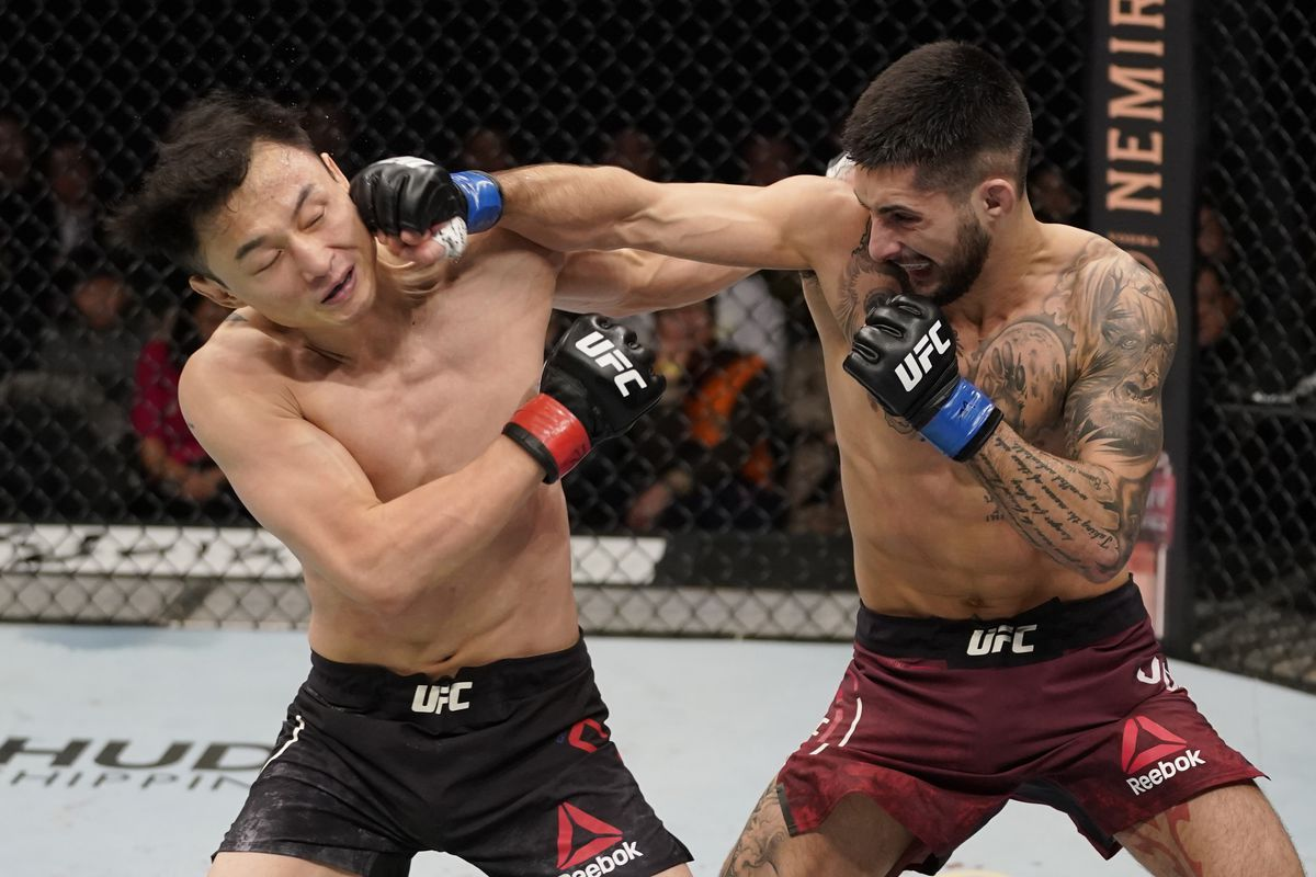 Charles Jourdain of Canada knocks out Dooho Choi of South Korea in their featherweight fight during the UFC Fight Night event at Sajik Arena 3 on December 21, 2019 in Busan, South Korea.