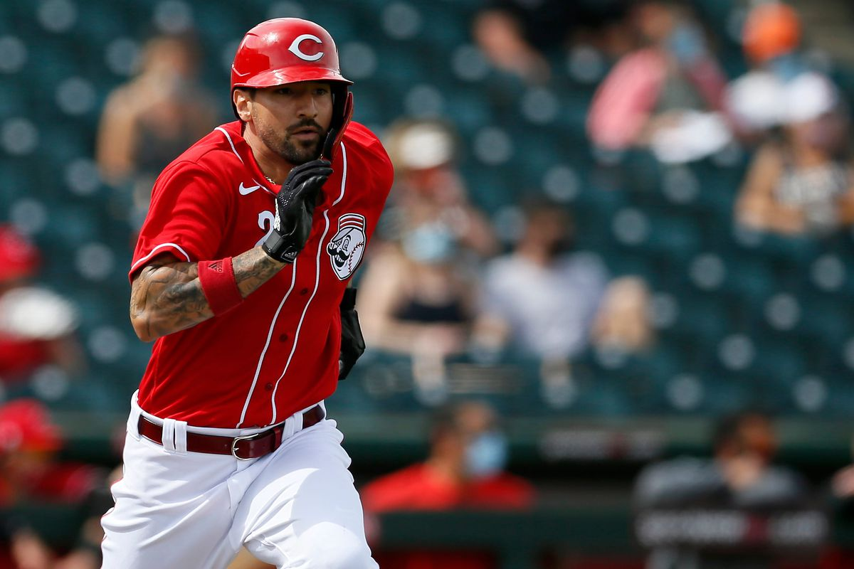Cincinnati Reds right fielder Nick Castellanos attempt to leg out a ground ball in the first inning of the MLB Cactus League Spring Training game between the Cincinnati Reds and the San Francisco Giants at Goodyear Ballpark in Goodyear, Ariz., on Sunday, March 7, 2021.