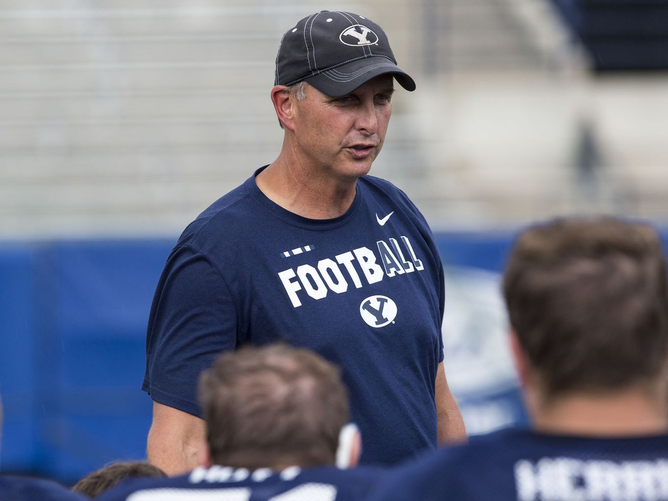 Offensive coordinator Ty Detmer talks to his players after a BYU football practice in Provo on Thursday, Aug. 10, 2017.