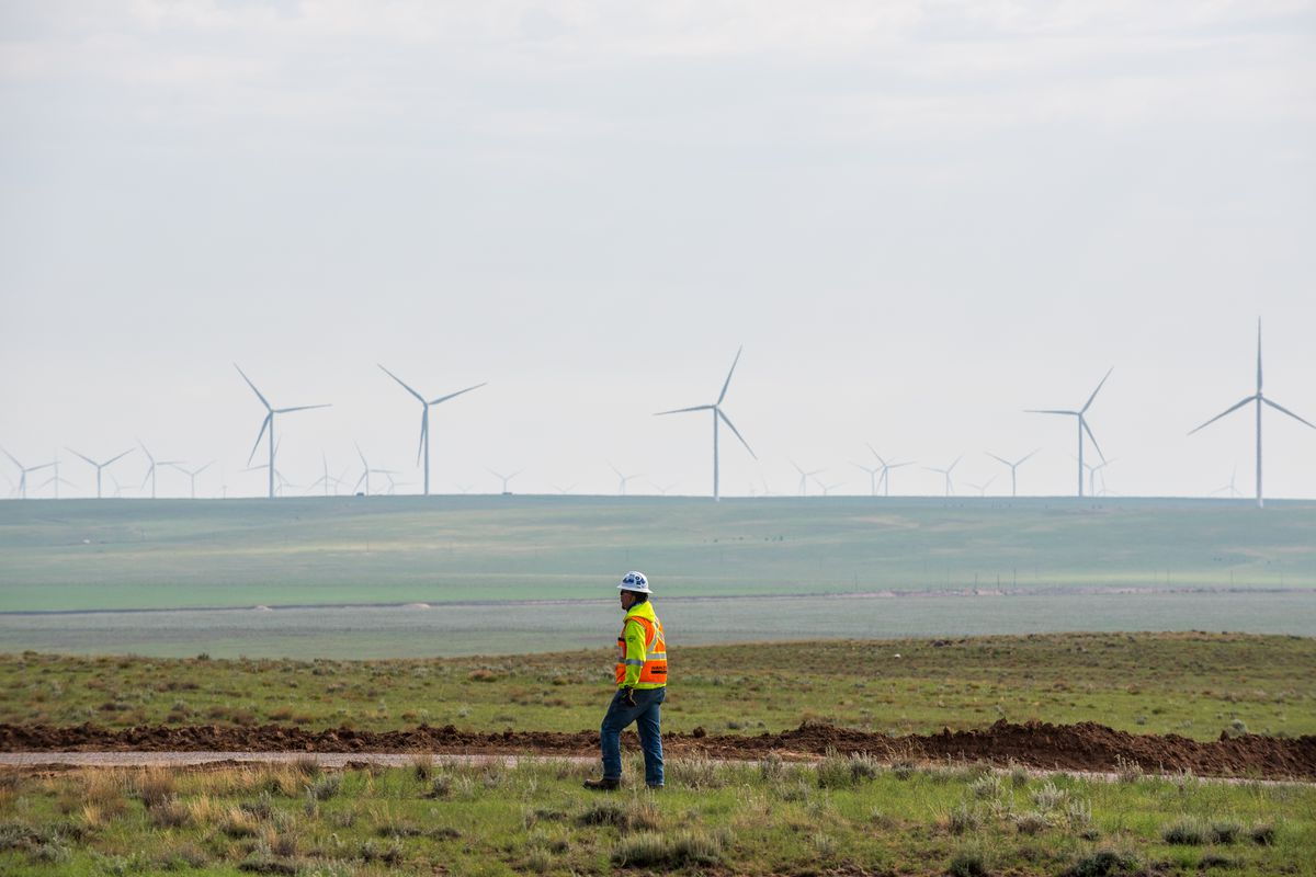 A construction worker walks along a dirt road at the Avangrid Renewables La Joya wind farm in Encino, New Mexico, on Aug. 5, 2020.