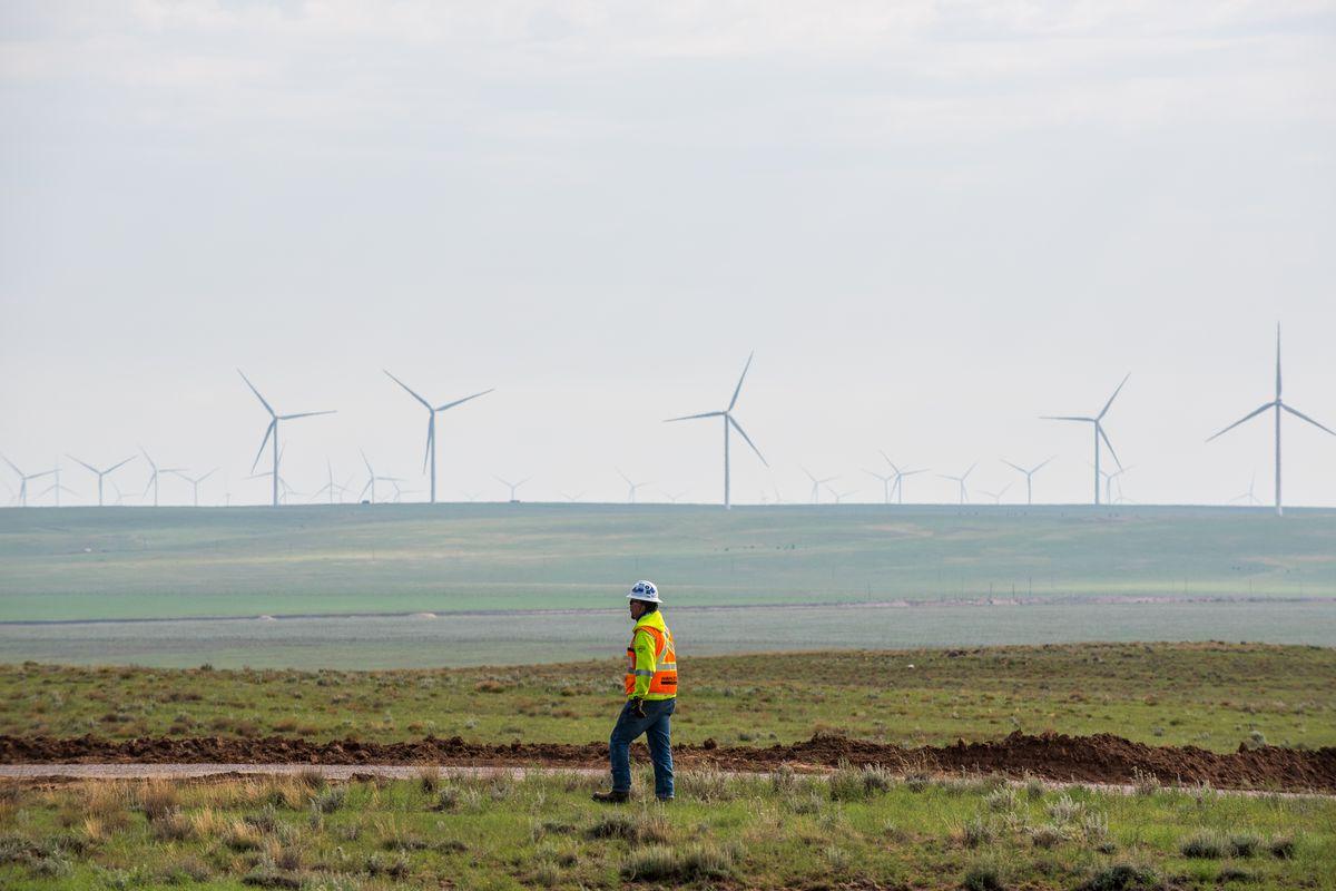 A construction worker walks along a dirt road at the Avangrid Renewables La Joya wind farm in Encino, New Mexico, on Aug. 5, 2020.